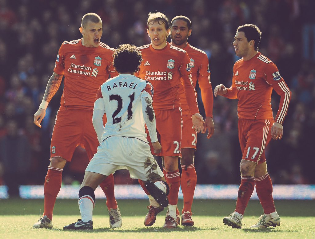 Rafael shows no fear as he stands up to Liverpool players at Anfield, 2011.