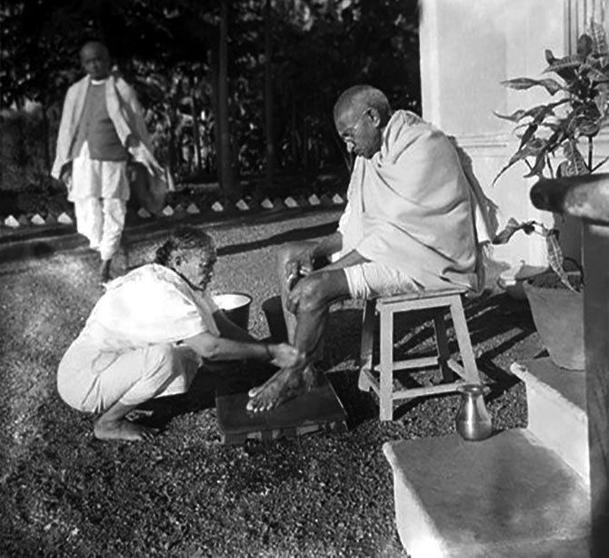 1939 :: Kasturba Washing Feet of  Mahatma Gandhi