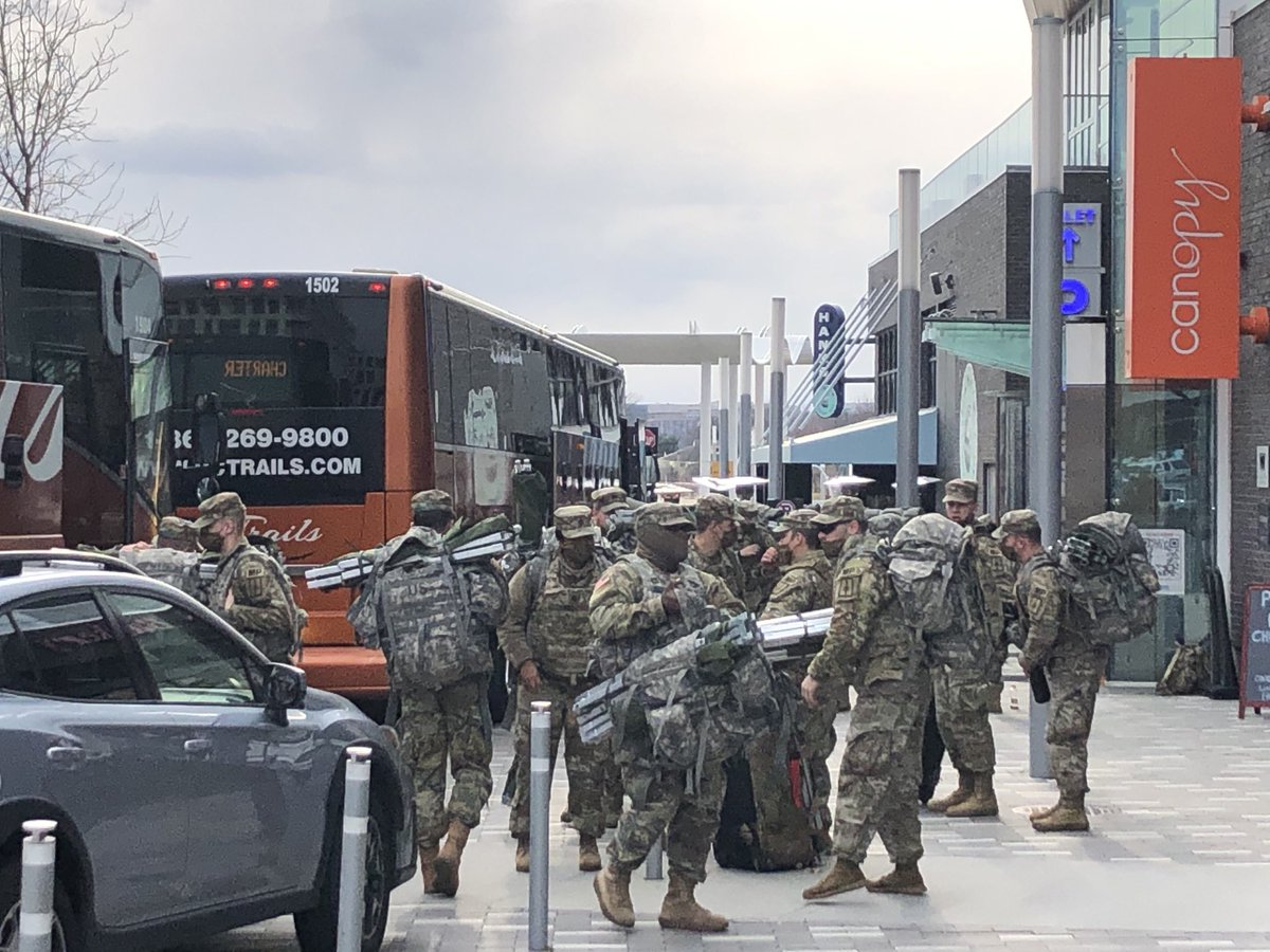 Replying to @HeathaT: Buses full of National Guard unloading near the Hank's Oyster Bar at DC Wharf #dclockdown