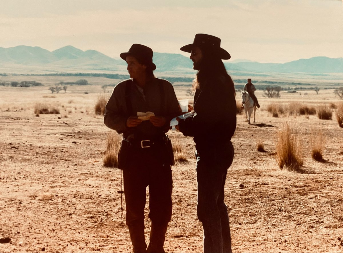 Me and Emilio on the Mexico border in 1989, discussing a scene during the filming of #YoungGuns 2. At the end of the shoot, he gave me his 1881 Colt Lightning. Guess I will need to give it back to him. No surrender for #BillytheKid