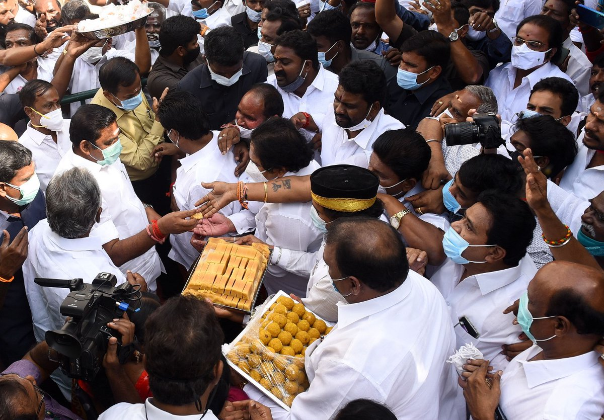 Chief minister Edappadi K Palaniswami distributing sweets during the 104th birth anniversary celebrations of former chief minister MG Ramachandran at AIADMK headquarters in Chennai.