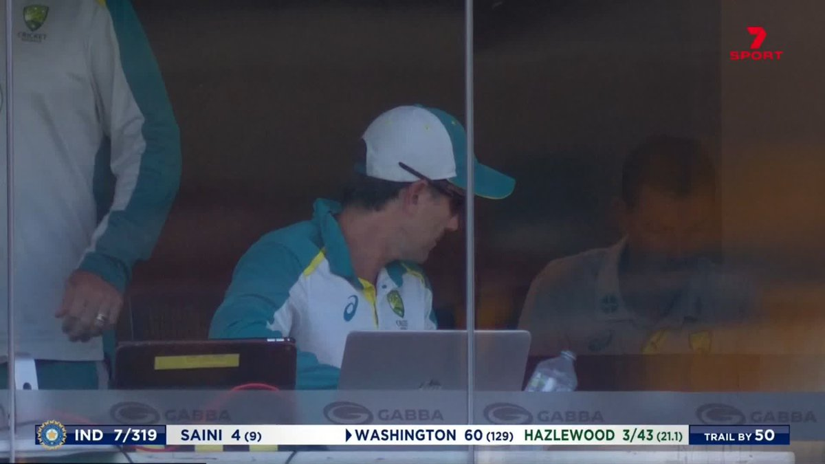 The water falls over next to Justin Langer's computer once...  And then it happens again! Everyone's lost it 😂  #AUSvIND