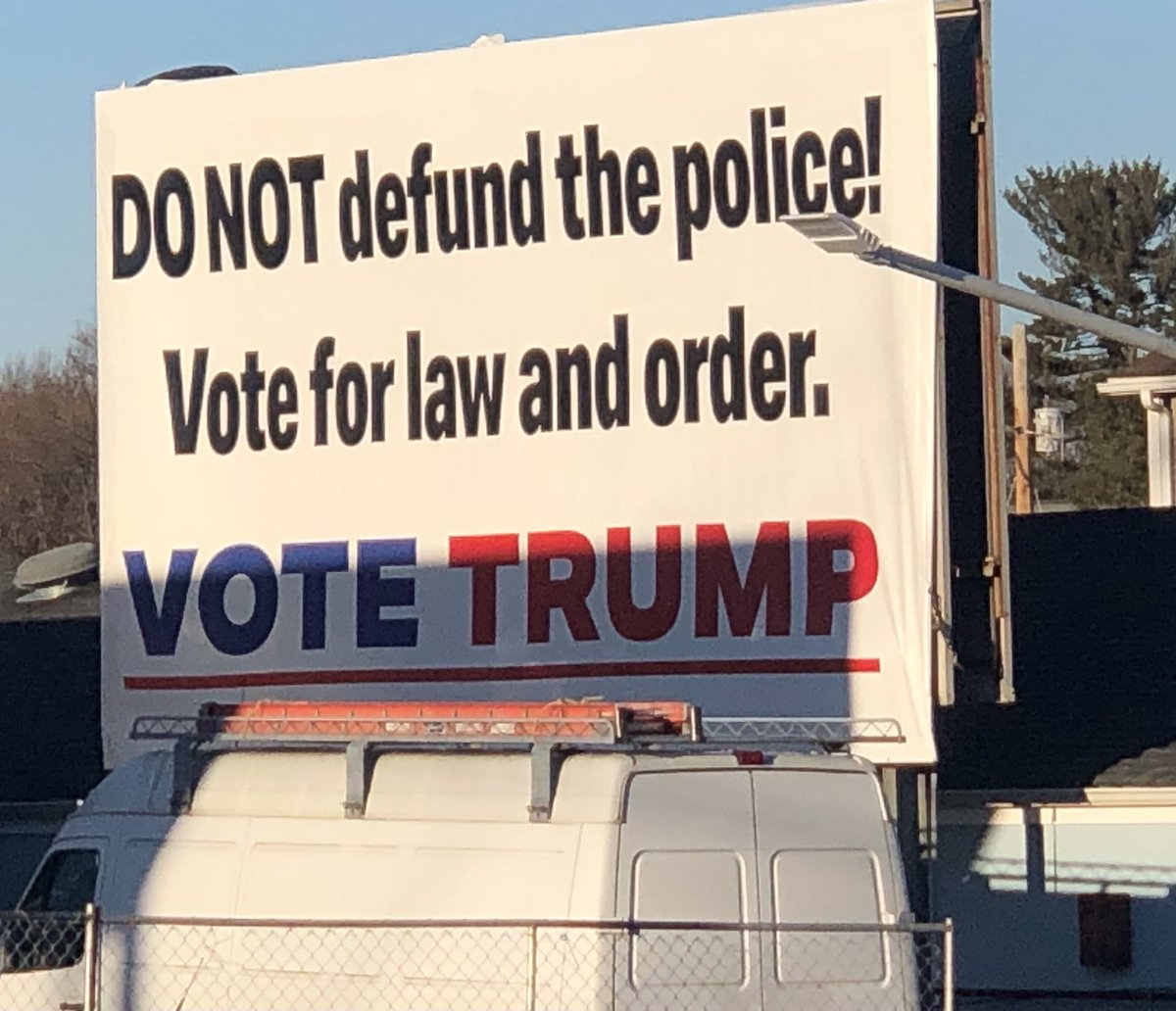 @Out5p0ken @chipfranklin This billboard is One block from a PD.  Had to do a uie and take this pic.  UNBELIEVABLE!  This is near car dealerships.  That van was not taking it down.. PD promoting #TrumpCoupAttempt  #TrumpLost #DefundThePolice #CoupAttempt #Cult45 #DomesticTerrorism #TrumpTreason #Trump