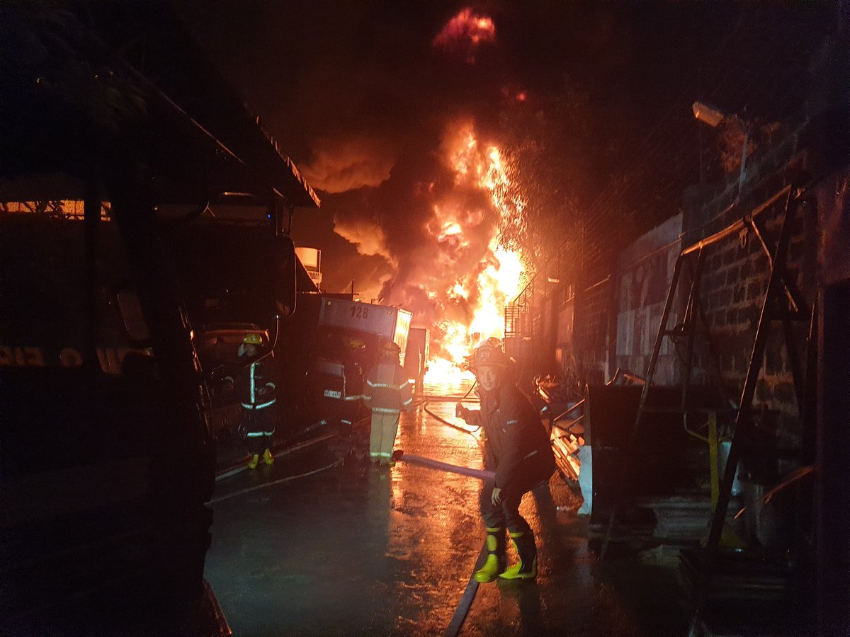 LOOK: Firefighters respond to a massive fire that broke out at the warehouse of Roosevelt Chemical Inc. in Brgy. Dela Paz, Pasig City on Sunday night. | @denverINQ  [📸: Marikina Filipino - Chinese Fire Brigade Volunteer]