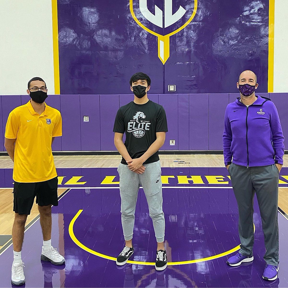 """6'6"""" G Adam Damian of Monte Vista (2021) on a visit at Cal Lutheran. Pictured with head coach Russell White and assistant coach Kris Saulny 🏀🔥 #ALLIN"""