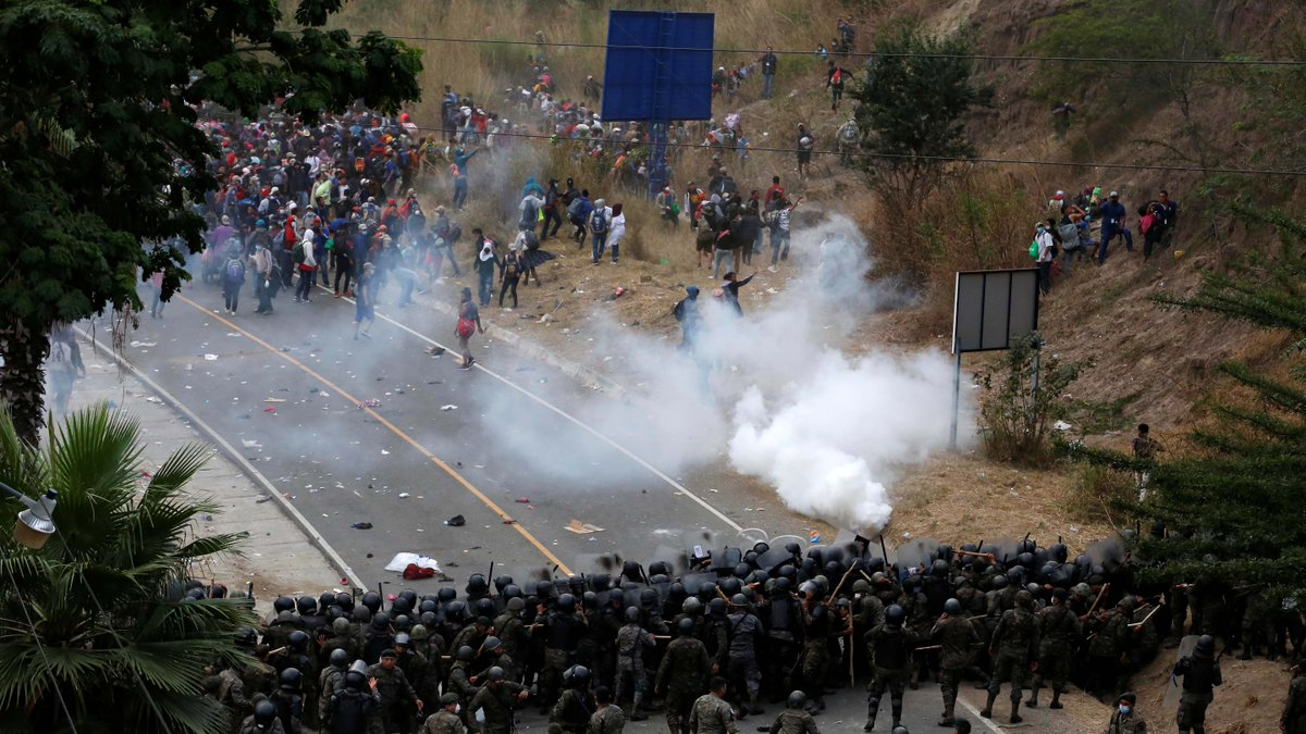 Tear gas was fired on Sunday as Guatemala police tried to disperse thousands of migrants headed for the United States on foot.