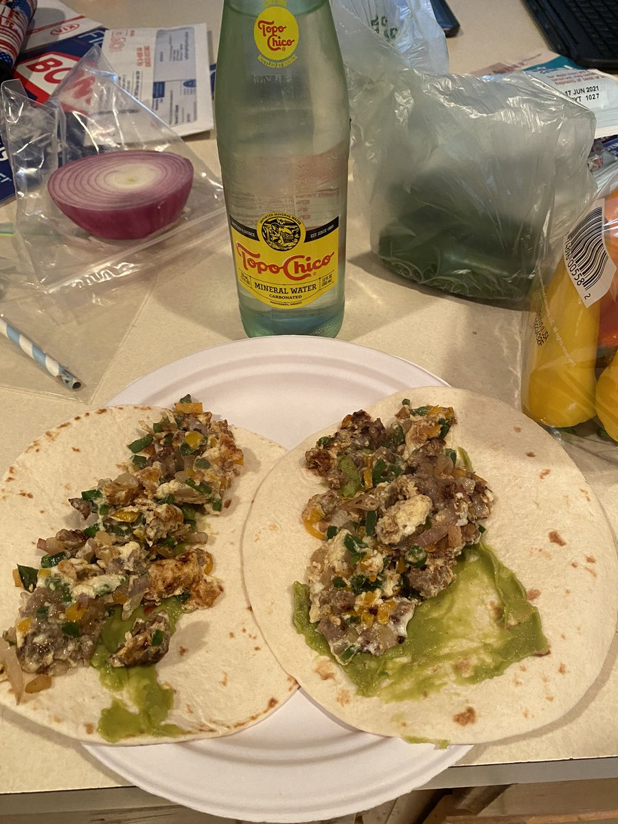 Sunday mornings are for breakfast burritos, an ice cold @TopoChicoUSA and @raywylie playing in the background #SundayMorning #livingmybestlife