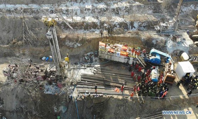 Workers trapped week in China mine ask for pickles, porridge Photo
