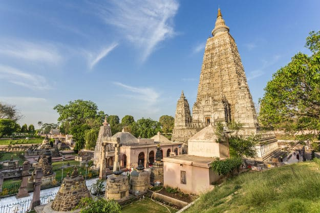 Mahabodhi temple in BodhGaya is one of India's oldest structures with an intriguing past. Here Gautam Buddha attained enlightenment under the Peepul tree. It is one of 1st Buddhist temples built entirely of brick.Declared a UNESCO World Heritage site in 2002. 📸WikkimediaCommons