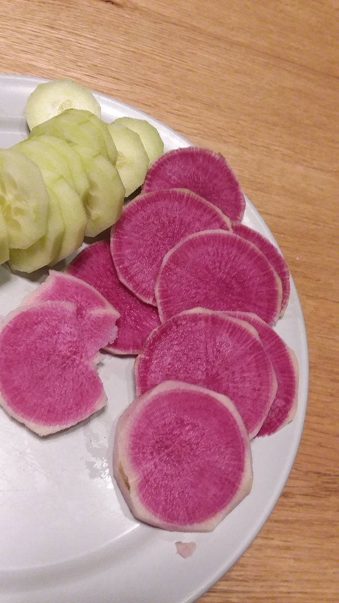 Watermelon Radish!  If you ever get a chance, try one!  (White/green on the outside and bright red on the inside. It's not too spicy)  #radish #foodie #yummy