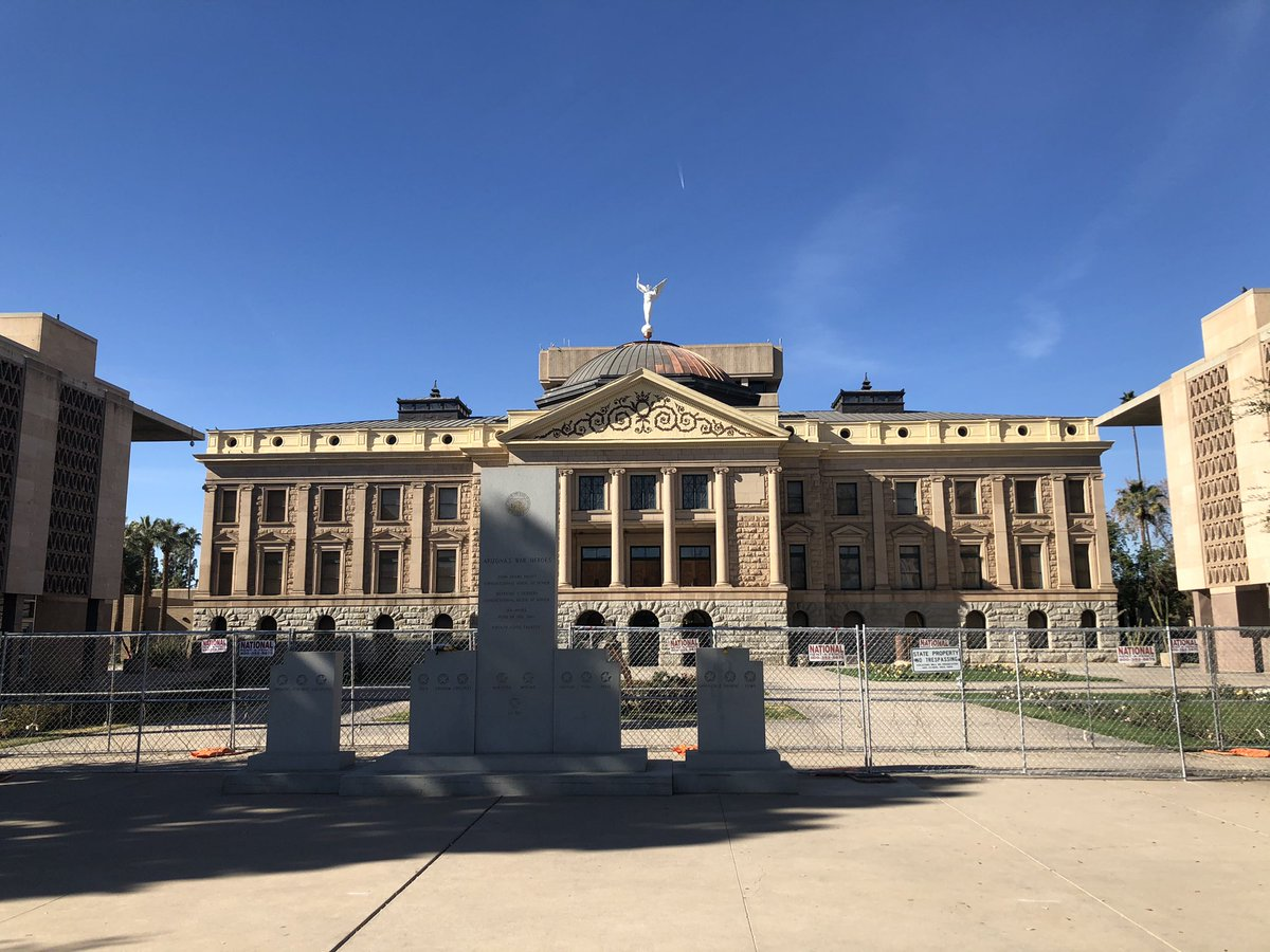 Double fencing, barbed wire, roadblocks, state and local police all guarding the area around the Arizona Capitol today