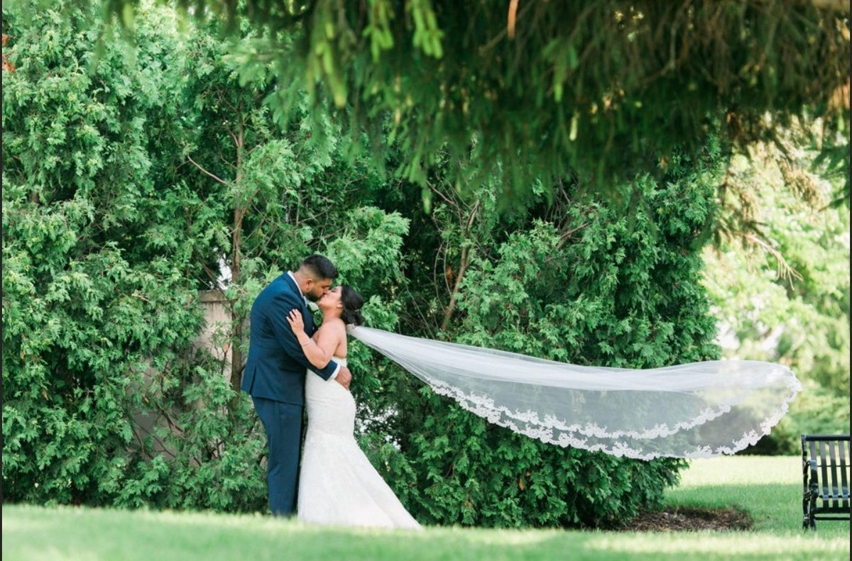 Gorgeous Beatriz and hubby on their wedding day. What a beautiful picture Photo by @BMPhotography  #love #weddingday #bride #happybride # #wedding #bride #weddinginspiration #weddingdress #weddingideas #bridetobe #weddingplanning #groom #bridalboutique