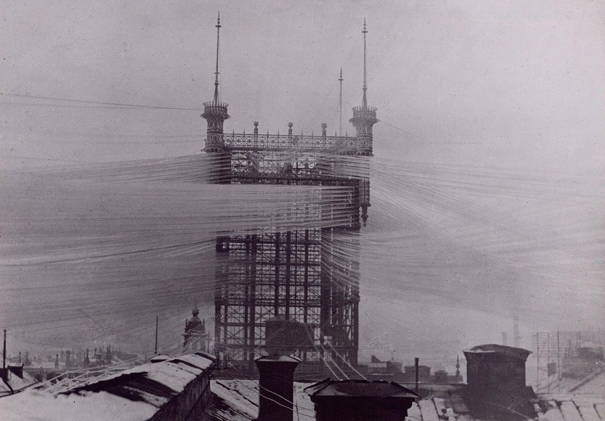 The fact that we are all connected via communication nets can feel abstract. Here's a time when it was less so: in the 19th century, individual telephone wires were needed for each phone, with scenes like this telephone tower in Sweden, streets in Kansas & 80 foot polls in NYC.