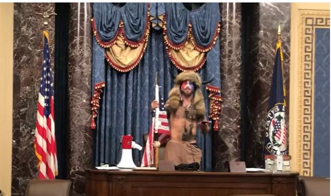 Astonishing pictures of QAnon Shaman Jake Angeli in the Speaker's Chair and the note he left Nancy Pelosi.   #TrumpInsurrectionists #trumpinsurrection #CapitolRiot #NancyPelosi #JakeAngeli