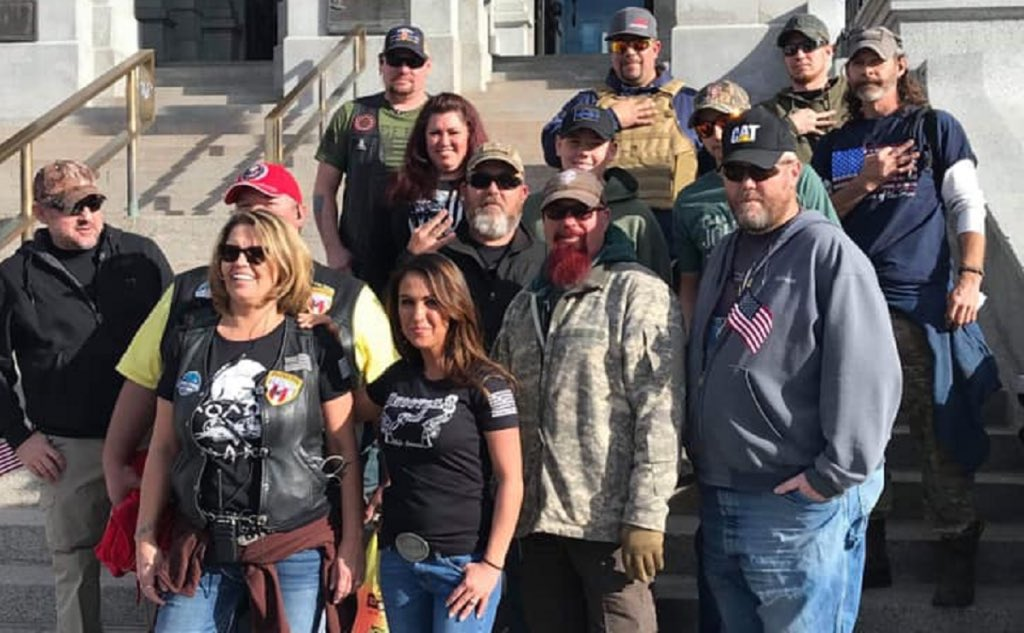 """This is @RepBoebert posing in 2019 with white supremacists flashing the """"white power"""" sign.  She is now a Republican Congressman.  Look up her arrest record. WTF is going on?"""