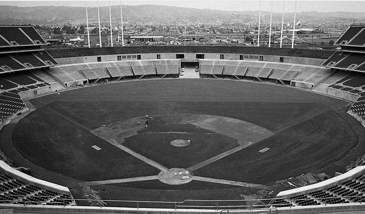 Oakland groundskeepers prepare the field for Oakland's first game at the Coliseum since moving west from Kansas City. It was beautiful before Mt Davis... year is 1968