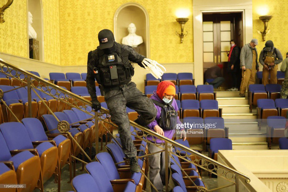 This guy is not law enforcement. He's wanna be larper cosplaying like he's in the military. But here he is inside the US capital with zip ties and a gun. These people were planning to take hostages. https://t.co/7xGwFE6JMm