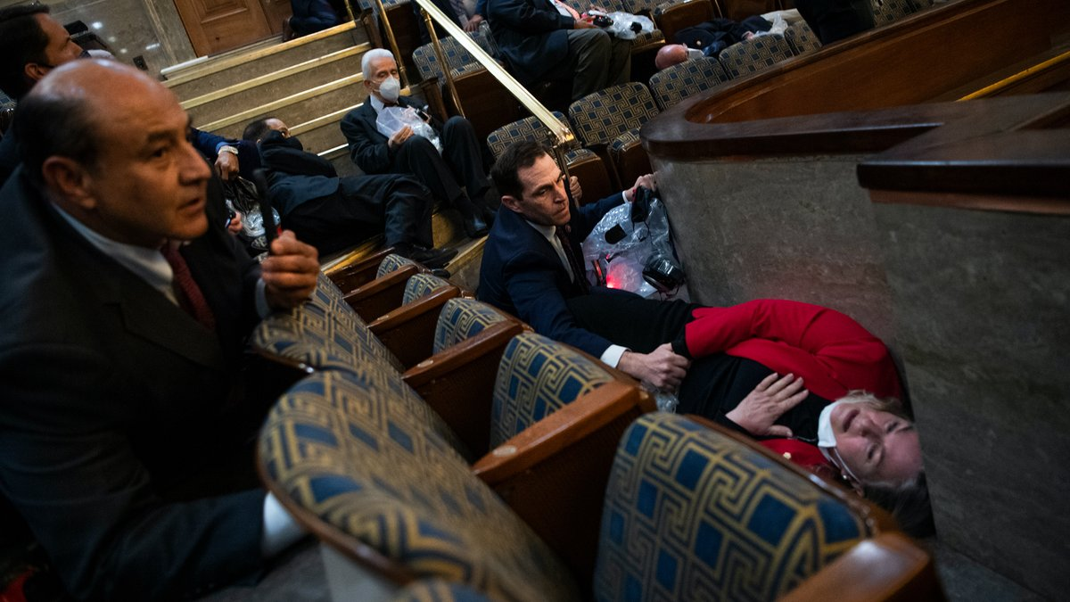 This photo breaks my heart.   Rep. Jason Crow, D-Colo., comforts Rep. Susan Wild, D-Pa., while taking cover as protesters disrupt the joint session of Congress to certify the Electoral College vote.  (Photo By Tom Williams/CQ Roll Call via AP Images) https://t.co/meMacsalq0
