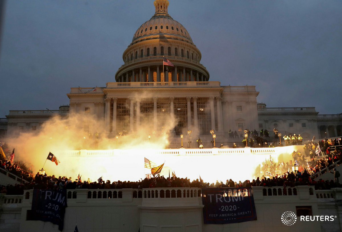 An explosion caused by a police munition is seen while supporters of U.S. President Donald Trump protest in front of the U.S. Capitol Building in Washington. Photo by @LeahMillis