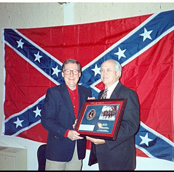 """@WaterDean FUNFACT: during five years of the """"Slaveholders Rebellion"""" in the 1860s there was never once a Confederate flag inside Capitol... for first time that occured today...  PICTURED: Senator Mitch McConnell accepting 'Racist Of The Year' award at Sons of Confederacy event circa 1996 https://t.co/J3oLBzHIst"""