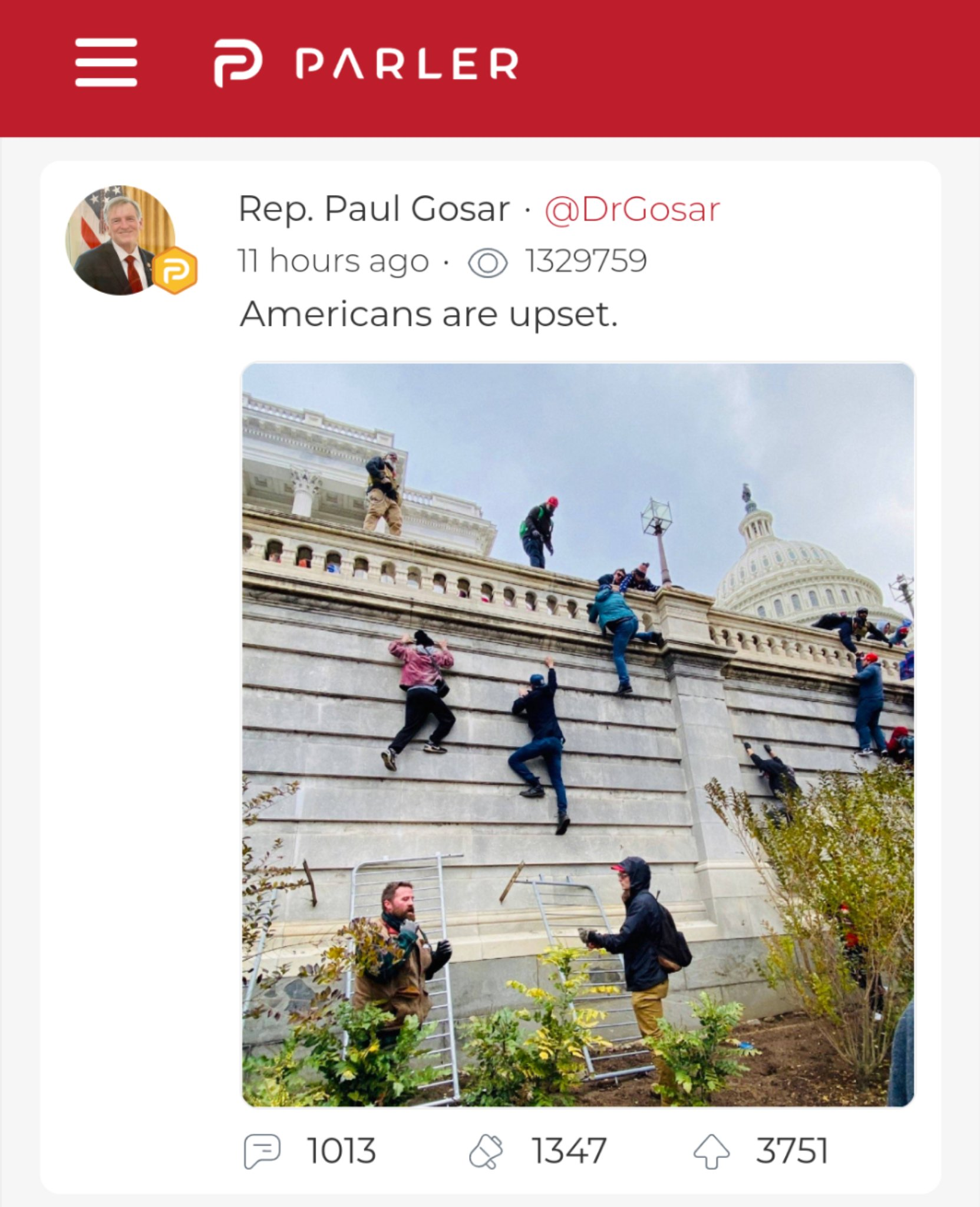 "Screenshot of Parler post from Congressman Paul Gosar that reads: ""Americans are upset."" It includes a photo of Trump supporters scaling the wall of the US Capitol."