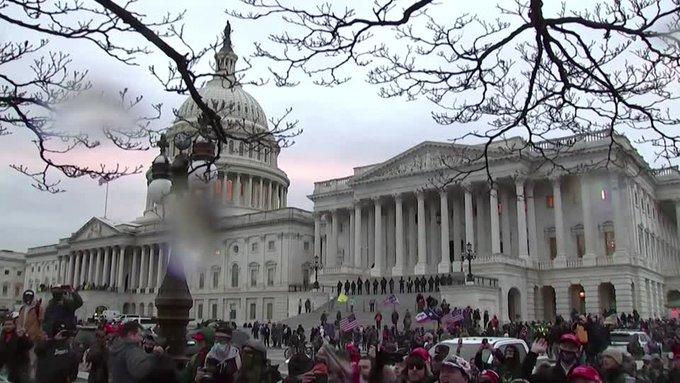 GLOBAL MARKETS-Stimulus helps stocks shrug off impeachment chaos Photo