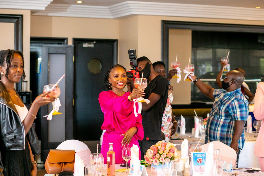 Guests make a toast at the A bottle of Gordon's Premium Pink Distilled Gin Launch