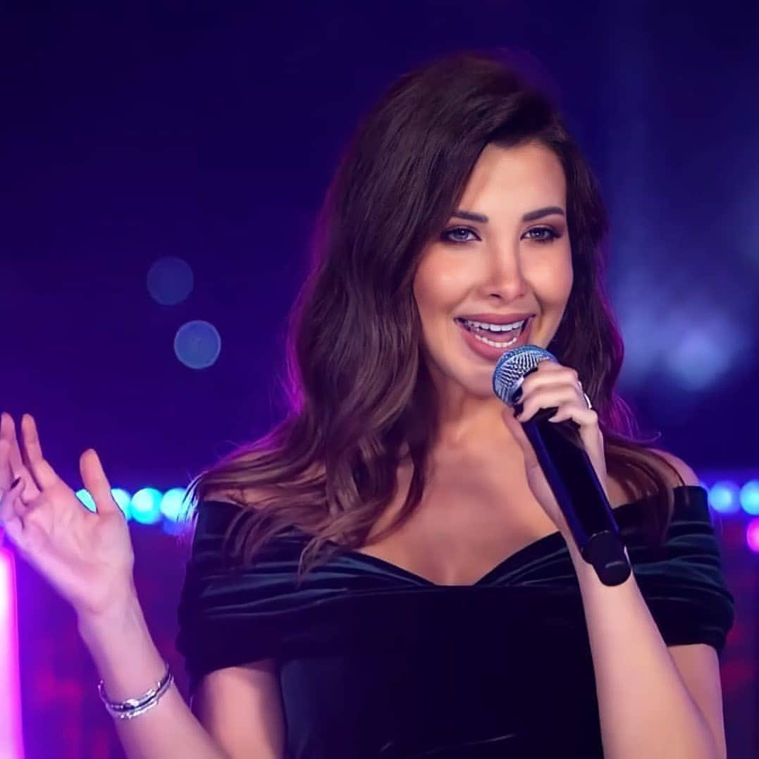 Replying to @NancyAjram: You can now watch New Year's concert 2021 on my YouTube Channel💜
