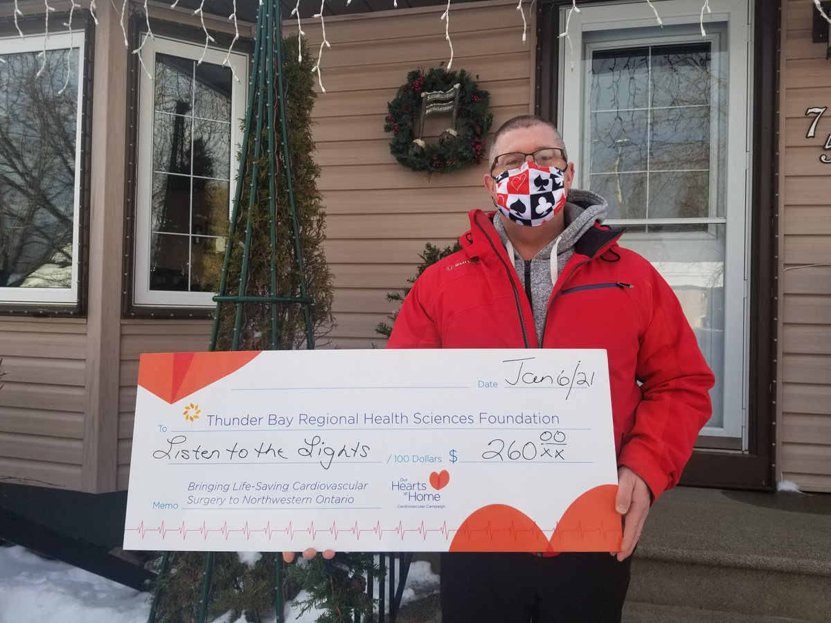 """James Hill's """"Listen to the Lights"""" display featured singing Christmas lights & a giant snowflake timed to festive music.  In 2020 he collected donations from visitors and raised $260 to help bring cardiovascular surgery to Thunder Bay & NWO!  Thank you James ❤ #OurHeartsAtHome"""