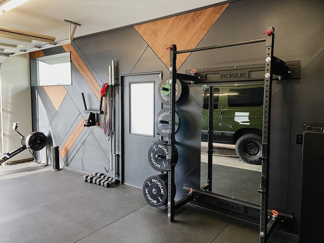 Garage gym courtesy of The Wild Is Home Design Co.