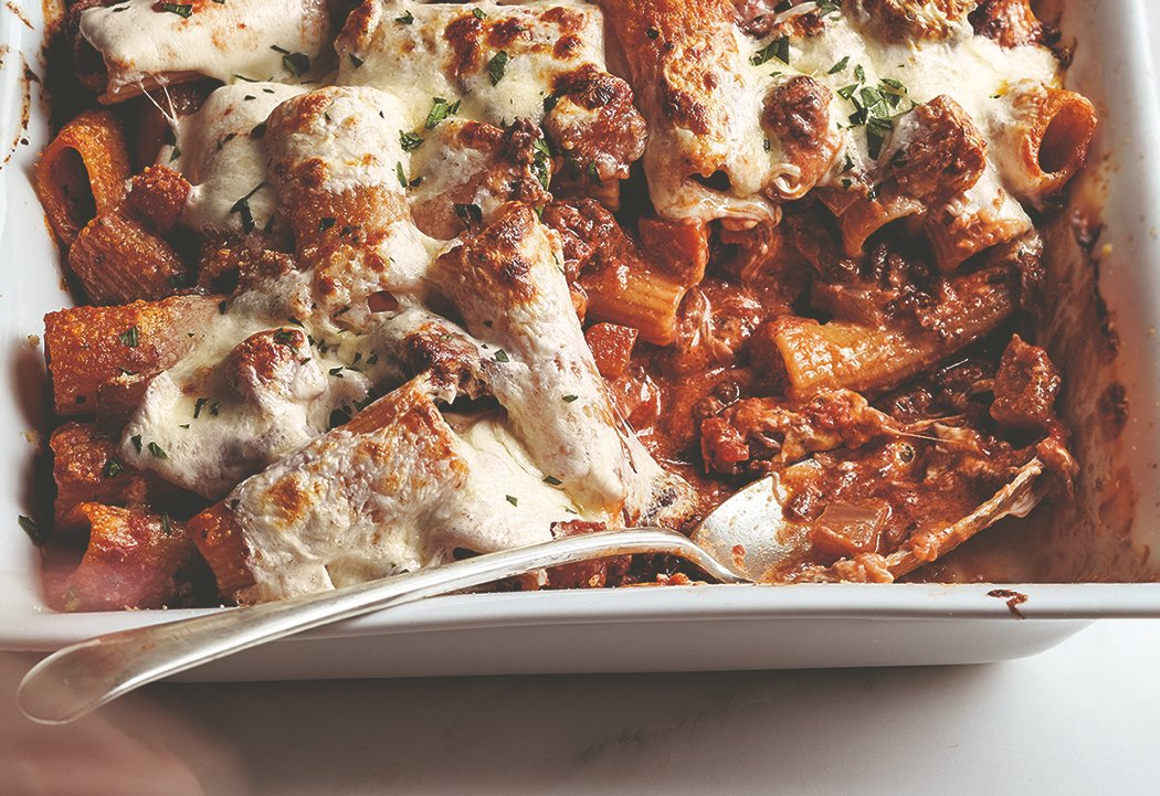 I'm a little cranky these days because it's winter, it gets dark early, and I can't gather with friends. This is when I crave a big bowl of stew or a cheesy baked pasta. With my Baked Rigatoni with Lamb Ragù, I don't have to choose because it's both!