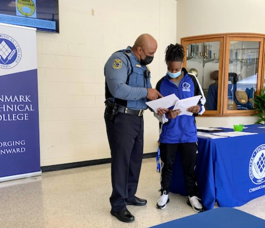 At Denmark Technical College, registration is a family affair. Here, Chief Bond assists a new student with filling out paperwork.