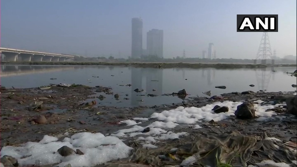 Replying to @ANI: Delhi: Toxic foam floats on the surface of river Yamuna.  Visuals from Kalindi Kunj area.