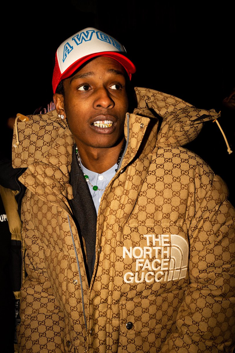 A$AP Rocky #ASAPRocky spotted in New York City wearing a down bomber jacket with allover GG motif  from the #TheNorthFacexGucci collaboration collection. Photo by #JulienMitchell. #AlessandroMichele @thenorthface