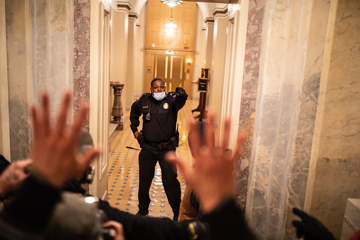 Officer Eugene Goodman stopped a mob of white rioters from entering the chambers of the United States Senate.  At this perilous moment in our nation's history, he was the one person standing between democracy and the rule of tyrants.  (Photo Credit: New York Times)