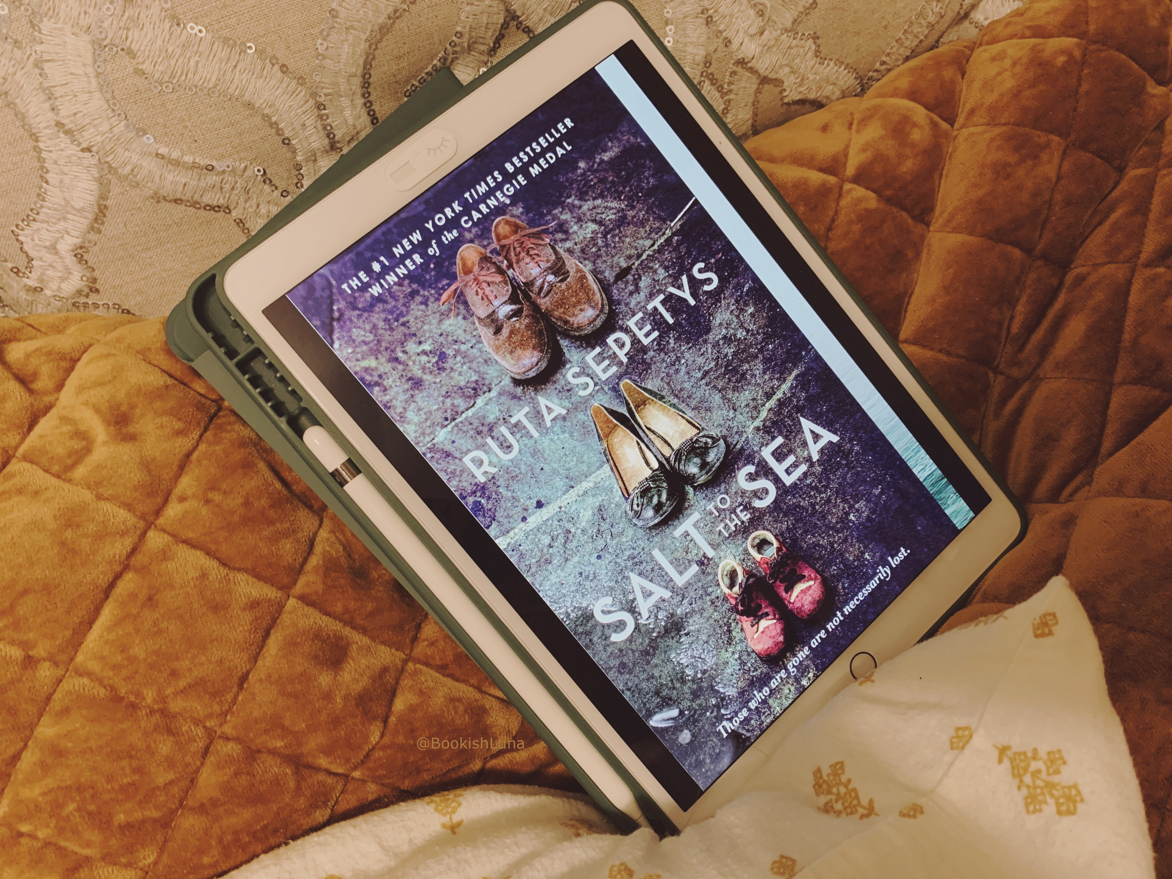 Salt to the Sea ebook on iPad placed on bed.