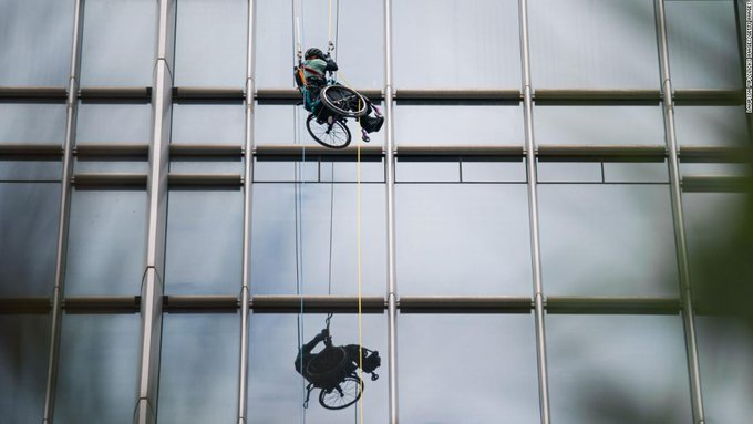 Paraplegic athlete in wheelchair climbs 820 feet up Hong Kong skyscraper Photo