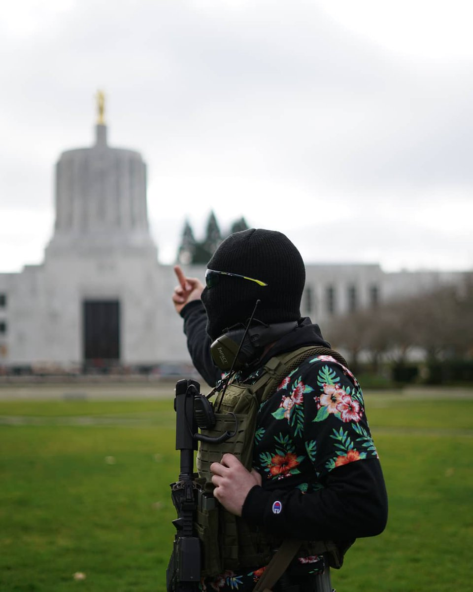 "A small group of BoogalooBoys gathers in front of the OR State Capitol building on Jan17th. After being asked what the Boogaloo's ideology was, members of the armed group declared, ""Opposing Fascism, opposing Authoritarianism, and opposing Government overreach""  #CapitolBuilding"