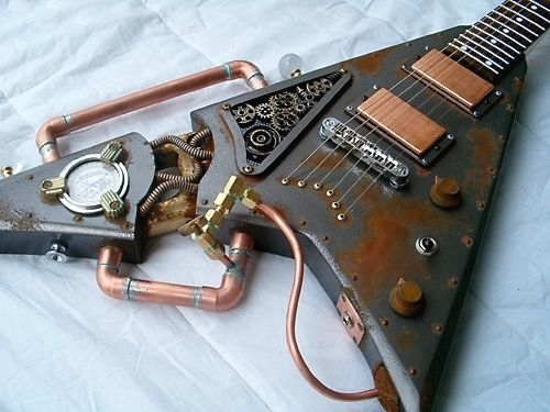 #Steampunk ⚙️ Awesome of the Day ⭐ ➡️ Customized Rusty #Guitar 🎸 With Copper Brass Tubing & Old Gauge via @SteampunkRadio ➡️ View More Selections 👉 https://t.co/Kugls3IJqU