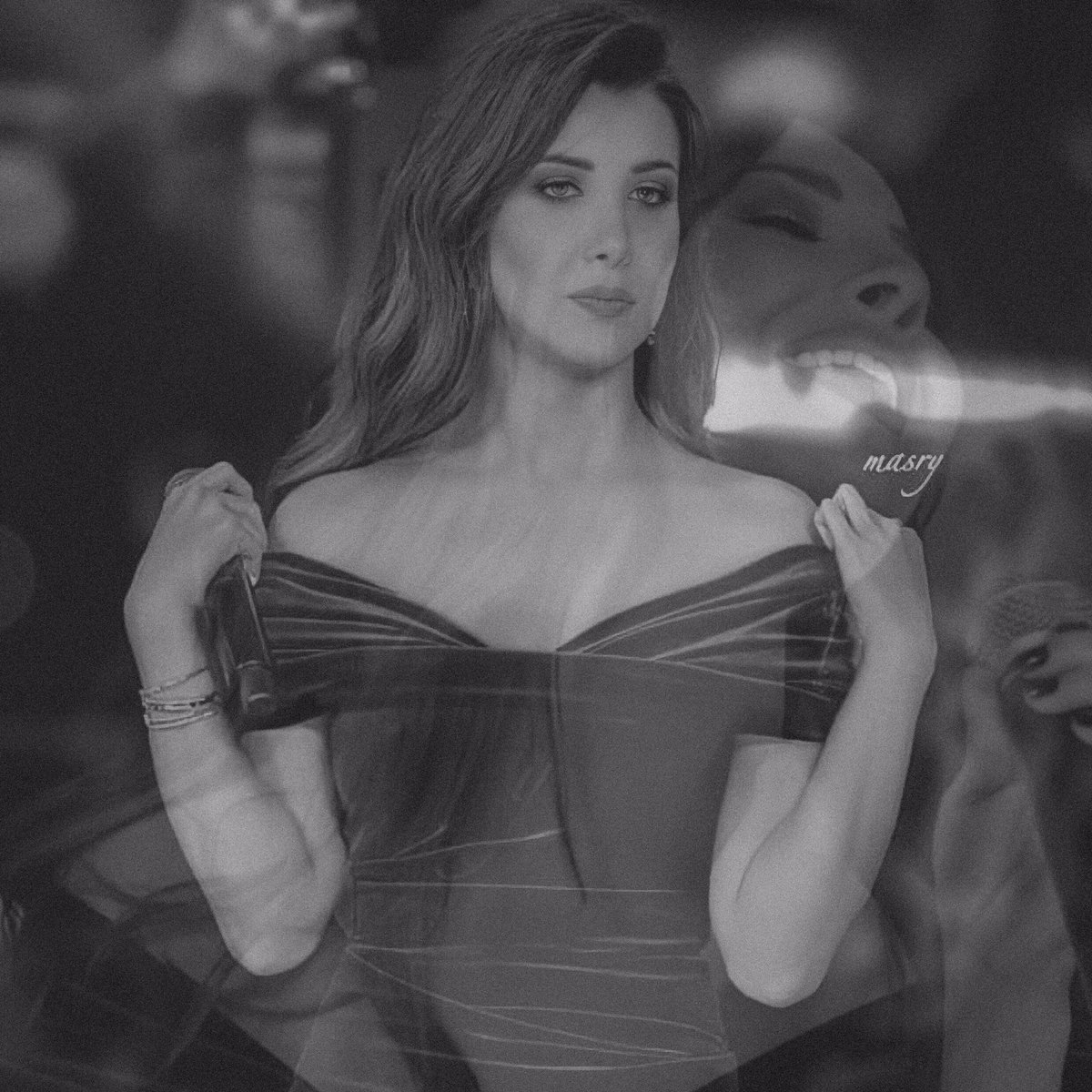 Replying to @nanso15: In love with this pic ❤️ @NancyAjram