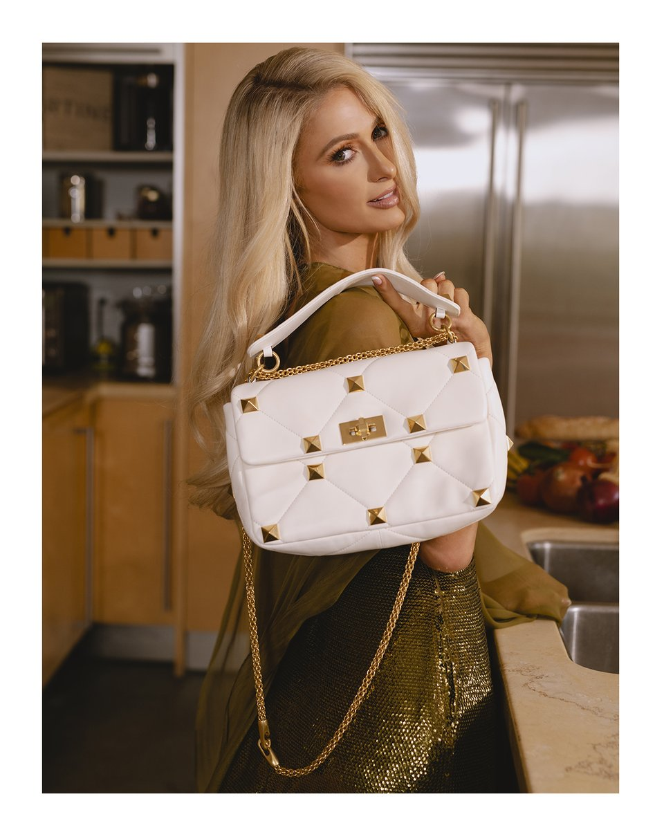 For a new story in @VogueMagazine, @ParisHilton  reveals a day in her life while dressed in full Valentino and carrying her essential bag, the Valentino Garavani #RomanStud.    #ValentinoNewsstand