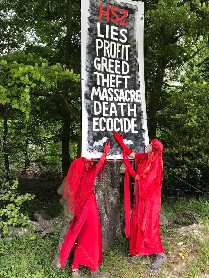 "#HS2 - a reminder from October 2020 of the #RedRebels at #JonesHillWood. ""Lies, Profit, Greed, Theft, Massacre, Death, Ecocide"" #HS2Rebellion #StopEcocide #StopHS2"