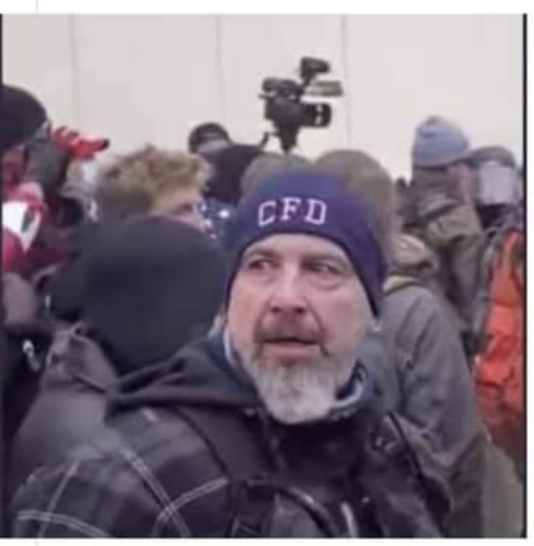 Notice the FBI has identified this person as the one who smashed a fire extinguisher into the skull of a Capitol policeman. If you can ID go to  and report. Or if you can ID the hat even purple CFD hat - some fire department???