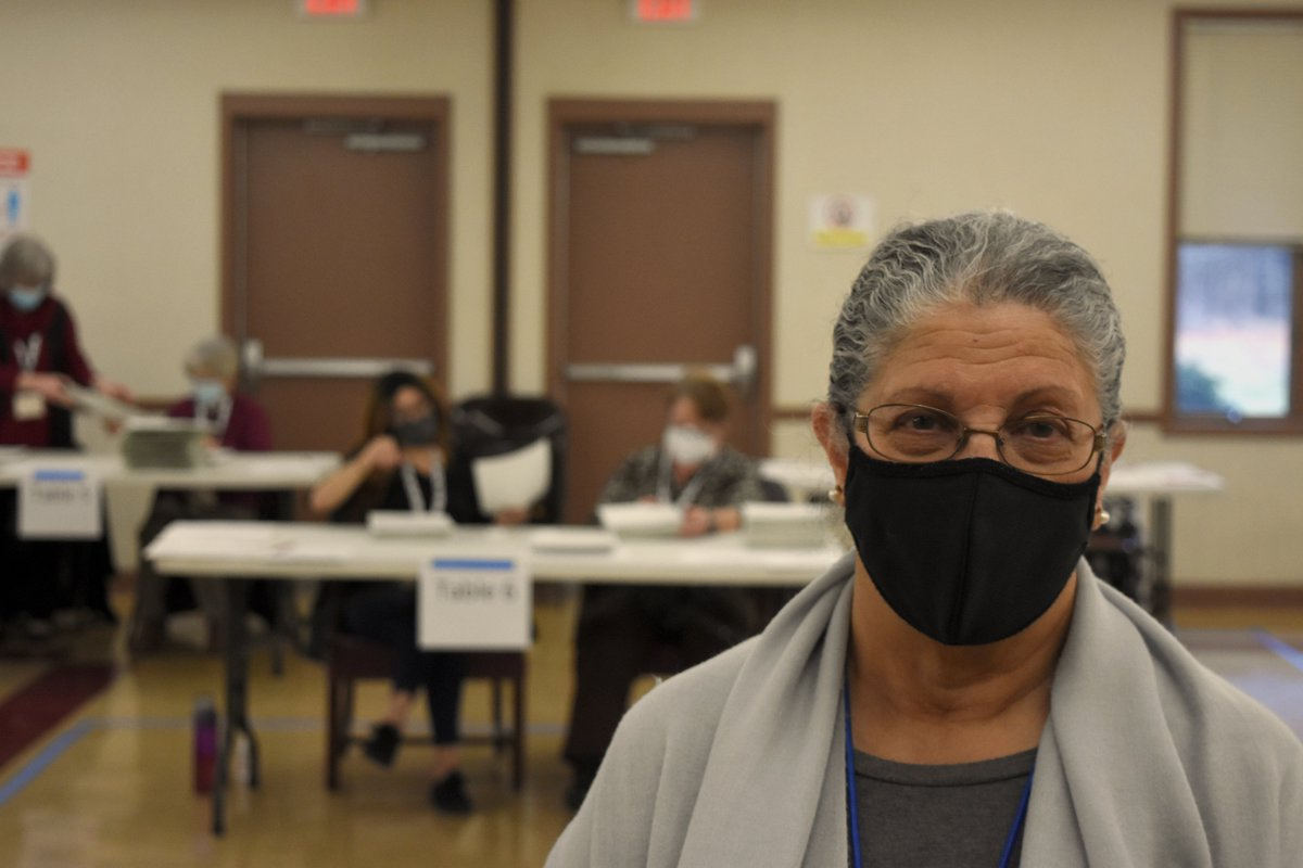 """Karen Tindall, 71, is a Democratic party monitor. She's volunteered as a poll watcher+absentee ballot adjudicator this cycle+says transparency is key.  """"I think we just need to talk about the process and explain it to people, because the elections are safe and they are fair."""""""
