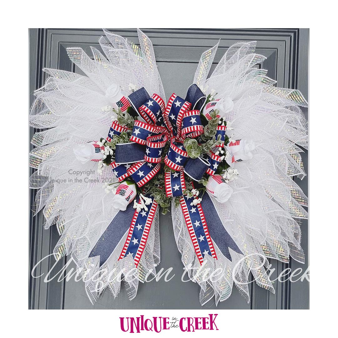 A beautiful #patriotic #wreath made on our new UITC Wing Wreath Board! There is so much you can do with this board!  UITC™ Wing Wreath Board 👇         #memorialday #4thofJuly #independeceday #fourthofjuly #Imadethis #crafting