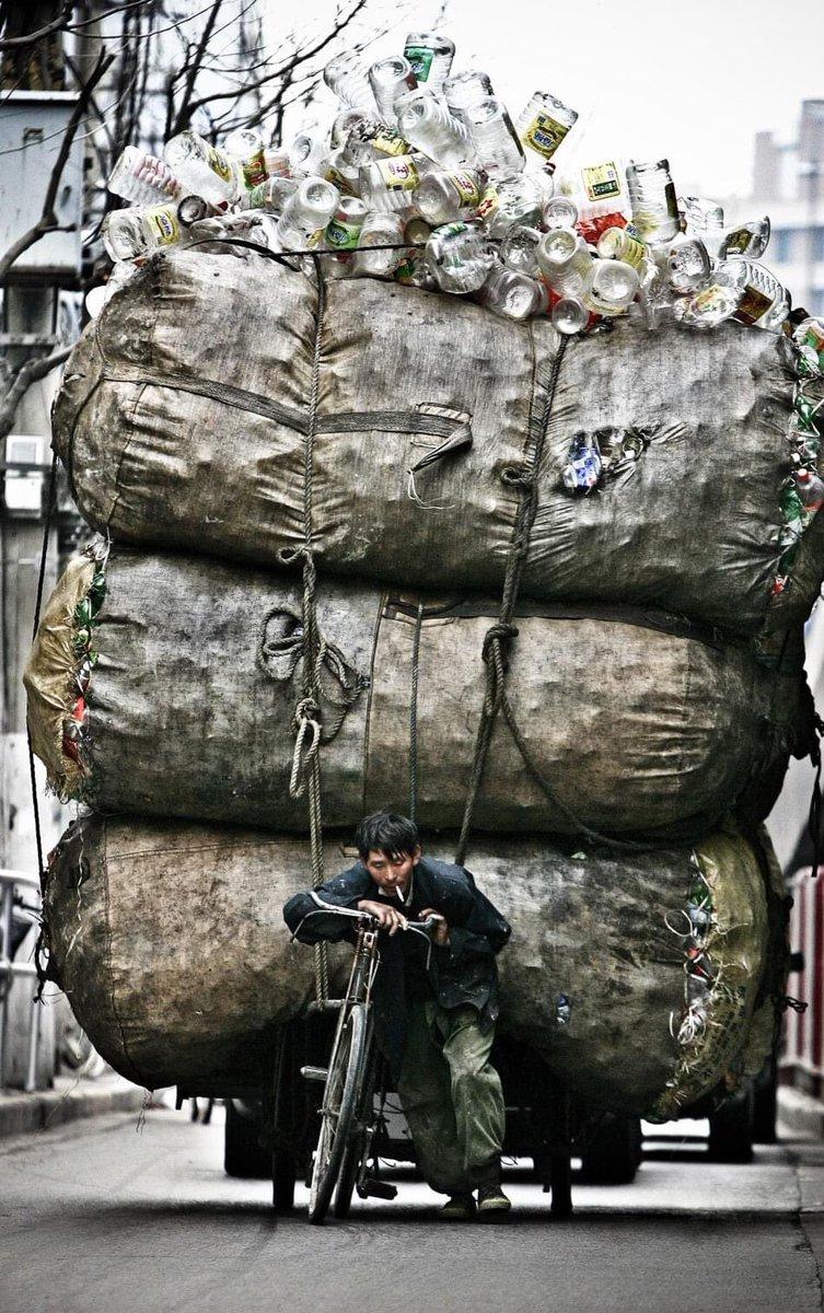 @thekiranbedi Future of a plastic bottle recycling man in Shanghai, China.