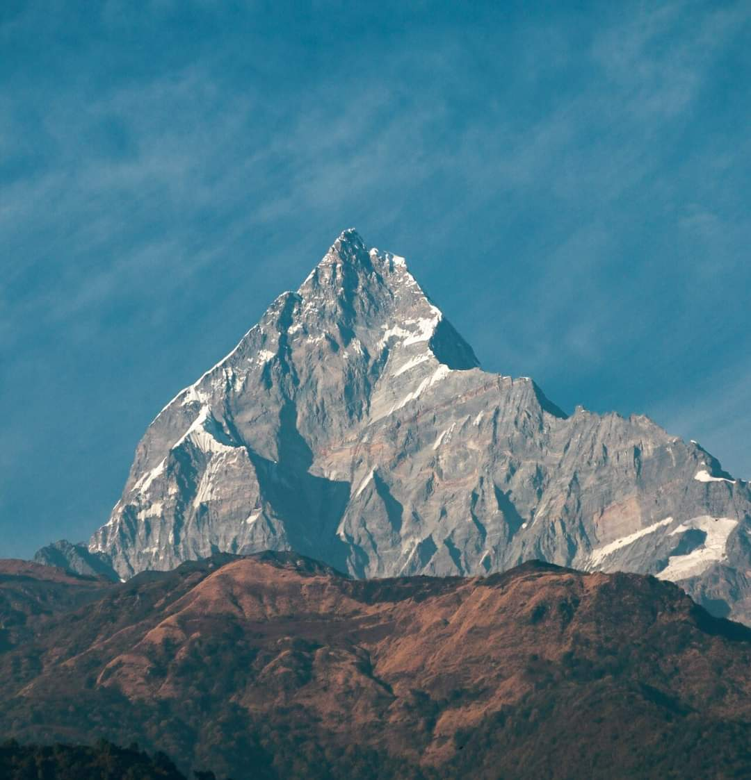 The #Machhapuchhre mountain in #Nepal,whose glory is marked by the snow formed on it every year. But,#climatechange has turned this natural beauty into just a #Snowless rock This hilly region is experiencing a yearly rise in Temp. by 0.4°C @GretaThunberg @LicypriyaK @vanessa_vash