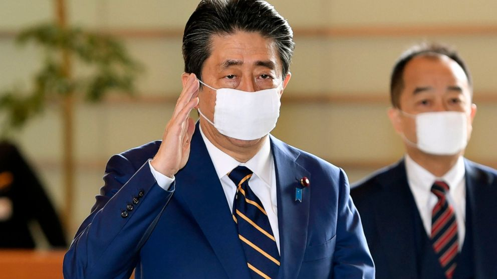 Japan widens virus emergency to 7 more areas as cases surge Photo