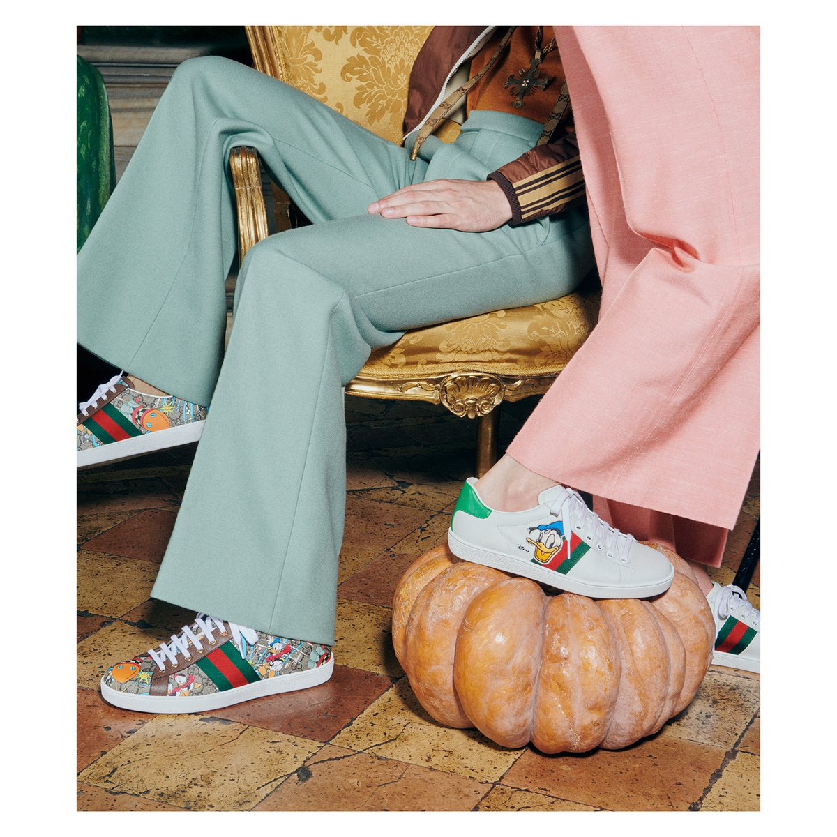 The #GucciAce sneaker, with its streamlined shape and House Web stripe detail, is printed with a Disney motif for the House's ongoing collaboration. Discover more . #DisneyxGucci #AlessandroMichele #GucciEpilogue