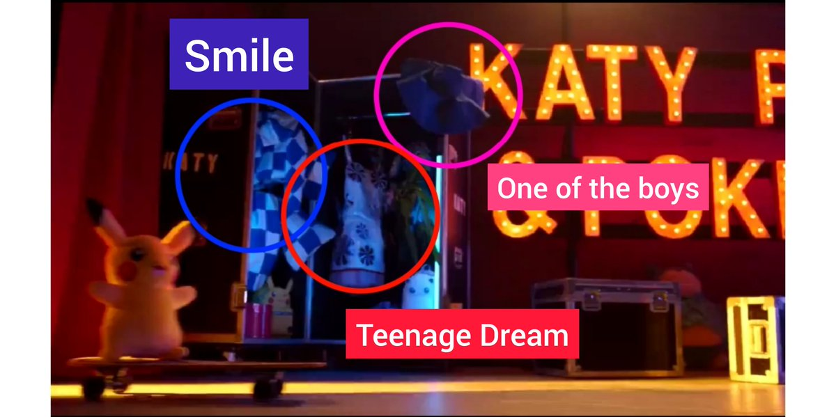 In the video of Pokémon they are things that represents each Katy Perry Era:  💗OOTB: The hat of the cover  ❤️TD: One of the mithic outfits of the tour 💛PRISM: The balloons of Birthday 💜WITNESS: The ball of CTTR 💙SMILE: The dress of the cover   I mean the details, her mind 💥